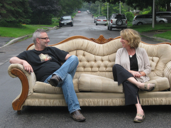 Dwayne Brown and Patti Church lounge on the iconic couch. Photo by Denise Deby