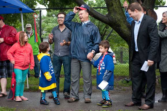 Brian Kearns with grandsons Cameron and William and happy onlookers. Photo by Kate Settle.