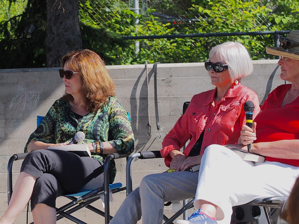 """""""A fabulous day, both in terms of the weather and the crowds of book lovers who trooped past our Capital Crime Writers and booth stopped to buy books and chat about crime-writing. I look forward to this becoming an annual community event,"""" saidBrenda Chapman, Kitchissippi resident, crime fiction novelist (left). Photo by Pearl Pirie."""