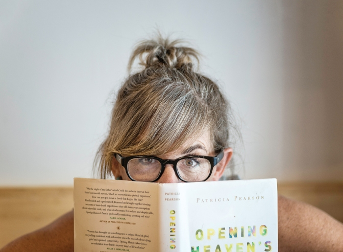 Hintonburg artist Andrea Stokes has two recommendations for your summer reading list. Photo by Ted Simpson