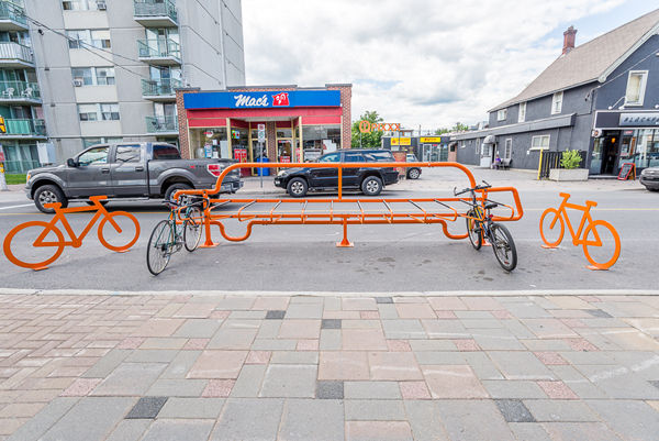 The bike corral takes up space of one car. Do cyclist visits generate the same income for the neighbourhood as cars? This new project might help find some answers. File photo by Ted Simpson