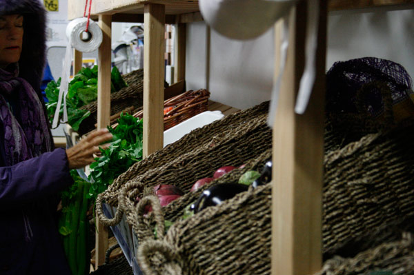 A customer peruses through Market Mobile's produce.