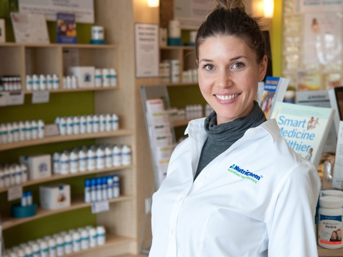 Alexandra Laureys, Registered Holistic Nutritionist, in the retail store at the NutriChem St. Laurent location.