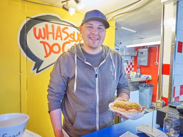 One of the newest additions to Kitchissippi is Wassup Dog, which has taken over the shack that used to be home to SuzyQ before they moved down the block. Jeff Hynes is the manager. Photo by Ellen Bond