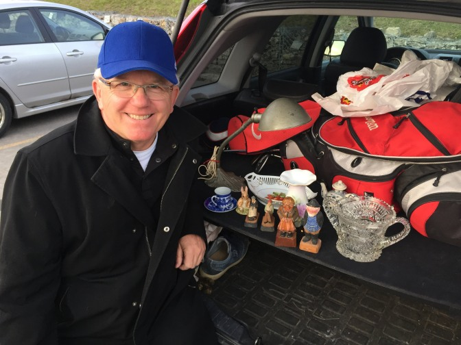 Shaun Markey with a few of his finds from the Kitchissippi United Church bazaar. Photo by Andrea Tomkins