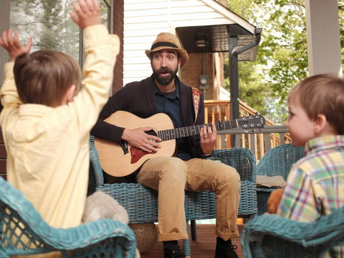 Derek McKinley's Sing Song Party Time is one of the family friendly acts that will be taking the stage at Westfest this year. He's pictured here on his Tweedsmuir Avenue porch with his children Oscar, 3, on the left, and Francis, 2, on the right. Photo by Ted Simpson