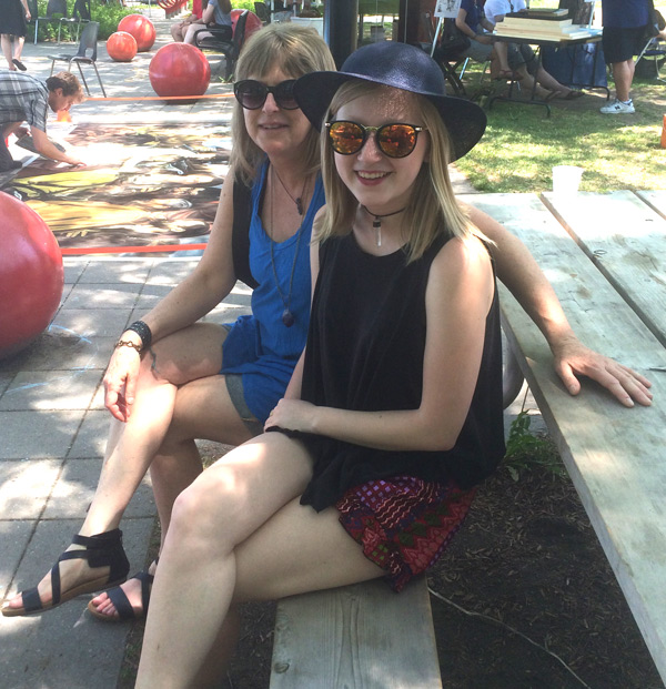 Barb Allen and her daughter, Maya, visit ArtsPark every year. These two Kitchissippi residents enjoy perusing and shopping at the craft vendors row, the music, the artists, and catching up with neighbours and friends.
