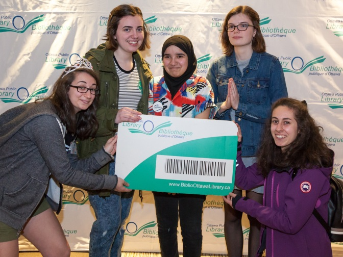 Nepean High School students Dahlia Ippolito, Anna Kollenberg, Zineb Nour, Claire Keenan, and Vanessa Ippolito pose in front of our photobooth at the Teen Tech Awards Night.