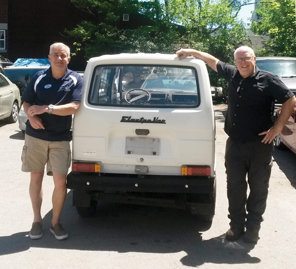 John Rapp and Frank Gifford with Dovercourt's new/old electric vehicle. It will be on the road later this summer. Photo by Bradley Turcotte