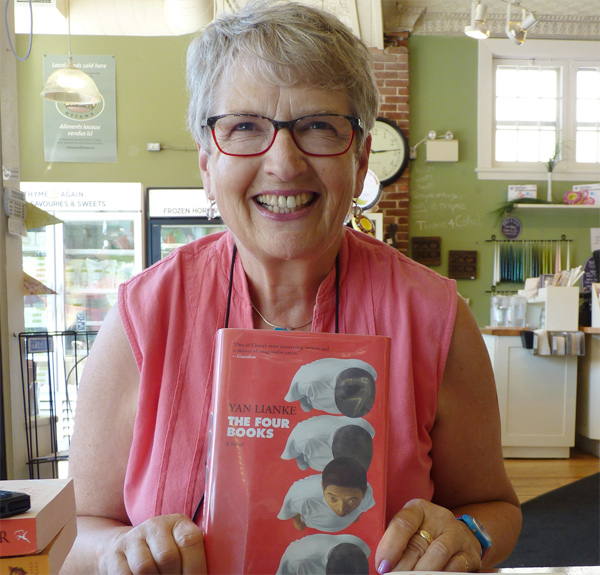 Barbara Clubb, former chief librarian of the Ottawa Public Library, with some of the books on her summer reading list. Photo by Judith van Berkom