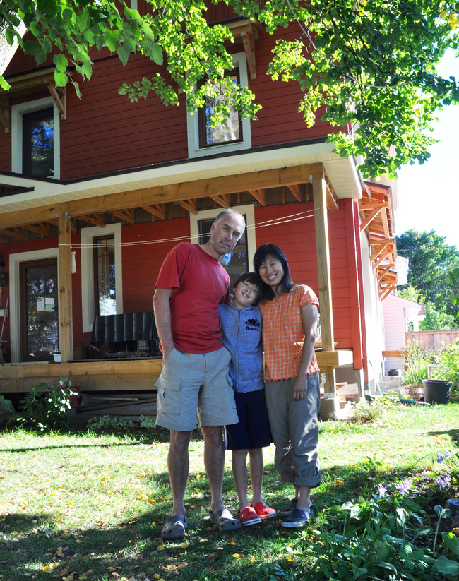 Malcolm Edwards, Melinda Tan and their son Saer live in this energy efficient home in Westboro. Photo by Andrea Tomkins