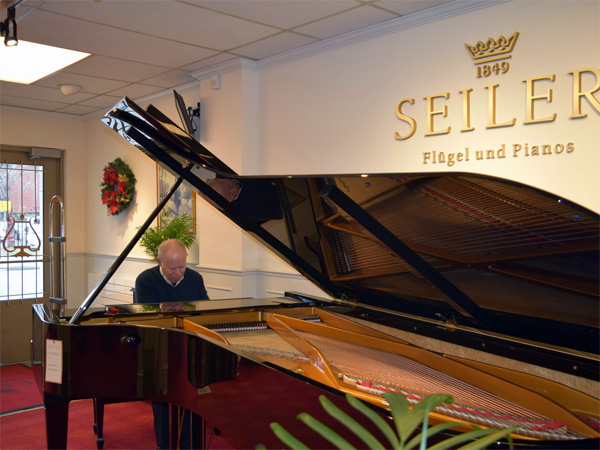 Ken Lauzon of Lauzon Music plays Canada's only 9-foot Seiler concert grand piano. Photo by Alyson Queen