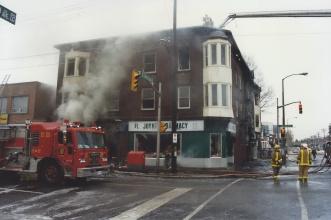 A photo of the Joynt's Pharmacy/Goldwyn Apts building on fire in December 1996. Photo courtesty of Ian McCord