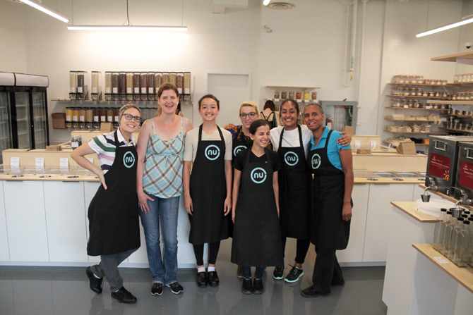 "The management and employees of Nu Grocery gather for a group photo on their ""soft"" opening day, which was heavily attended despite heavy rain. (L-R): Sia Veeramani, Valérie Leloup, Khema Stein, Kylie Shaw, Faezeh Khatami, Jasmine Acharya, and Sarah Parker. Photo by Jacob Hoytema"