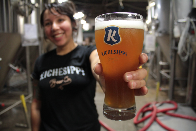 Kichessippi Beer's Jessica Trout shows off their German-style Heffeweizen at the K Beer brewery on 866 Campbell Ave., just outside Kitchissippi ward borders.