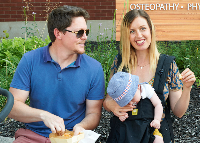 John and Rebecca Bruser recently moved to Ottawa from the Northwest Territories. They are enjoying their first experience at the Tastes of Wellington West with 3 1/2 month old Zach, who is sound asleep as they enjoy a pastry from a local shop.