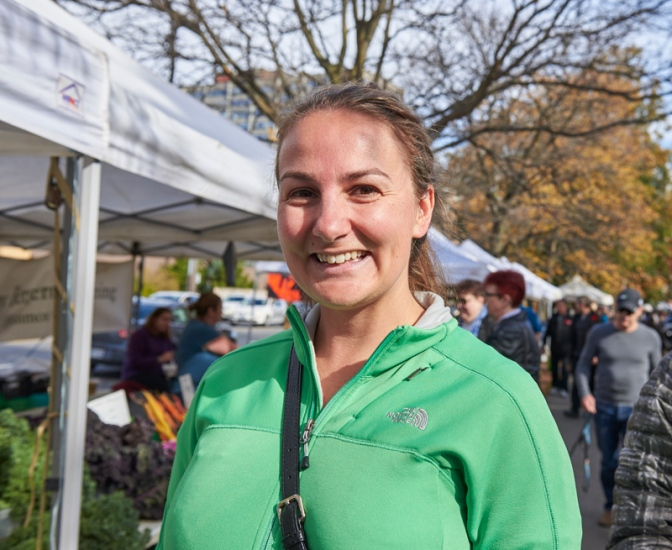 "Heather Cudmore: ""I love coming to the market because it's a great chance to run into neighbours. Also, I like taking advantage of lots of fresh produce, special items like maple syrup, and honey. It's part of my Saturday routine."""
