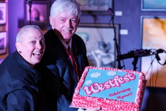 Westfest founder and producer, Elaina Martin celebrates 15 years of Westfest with sponsor, Thom Fountain, who she credits with keeping the festival alive through his support. Photo by Ted Simpson