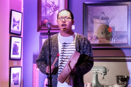 Theland Kicknosway opens the event by singing a prayer. Photo by Ted Simpson